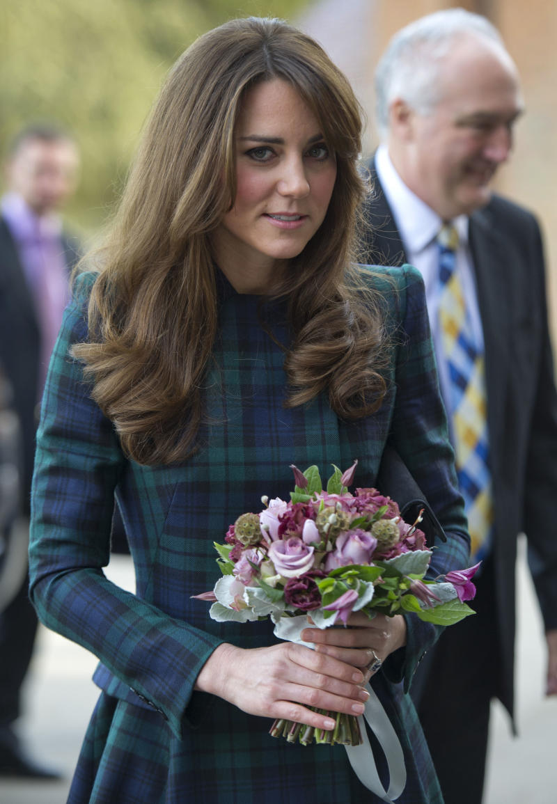 Britain's Kate, Duchess of Cambridge holds a posy as she visits St. Andrew's School, where she was a pupil from 1986 till 1995, in Panbourne, England Friday Nov. 30, 2012. Nov. 30 is St. Andrew's Day, and the school traditionally observes a day of activities and festivities to mark the occasion. (AP Photo/Arthur Edwards, Pool)