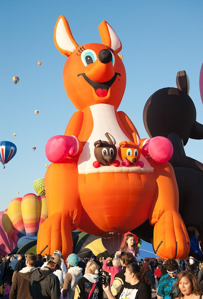 Kangaroo Polly and her joeys overlook the crowds on Day 5 of the 2010 Albuquerque International Balloon Fiesta on October 6, 2010 in Albuquerque, New Mexico. There are over 500 balloons representing over 45 countries participating in this year?s Fiesta. (Photo by Steve Snowden/Getty Images)