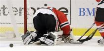 Chicago Blackhawks goalie Ray Emery looks for the puck during the first period of an NHL hockey game against the San Jose Sharks in Chicago, Friday, Feb. 22, 2013. (AP Photo/Nam Y. Huh)