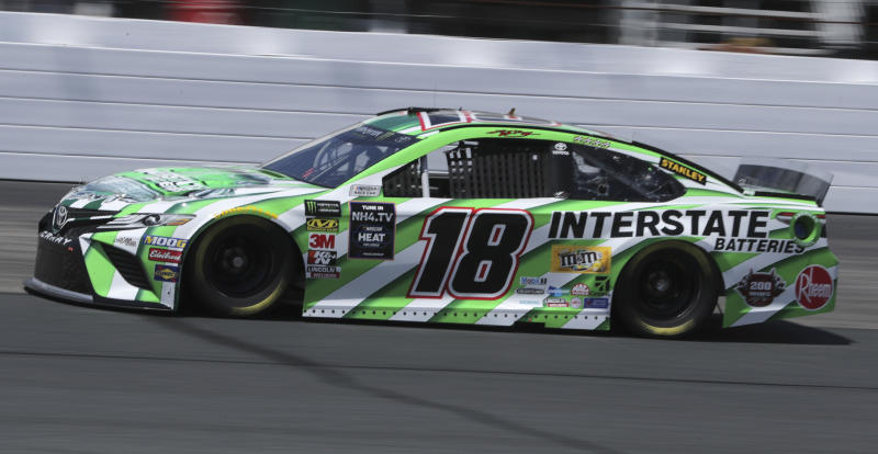 Kyle Busch (18) heads down the track during a NASCAR Cup Series auto race practice at New Hampshire Motor Speedway in Loudon, N.H., Friday, July 19, 2019. (AP Photo/Charles Krupa)
