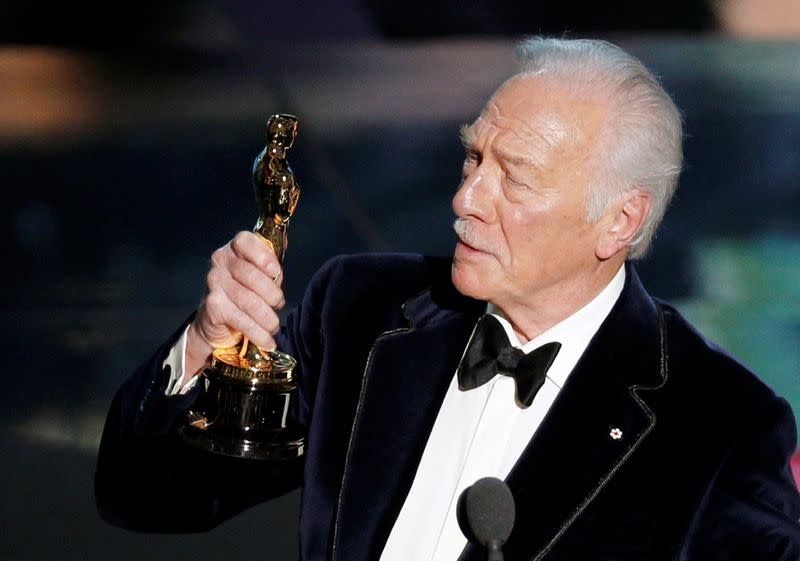 """FILE PHOTO: Plummer, accepts the Oscar for best supporting actor for his role in """"Beginners"""" at the 84th Academy Awards in Hollywood"""
