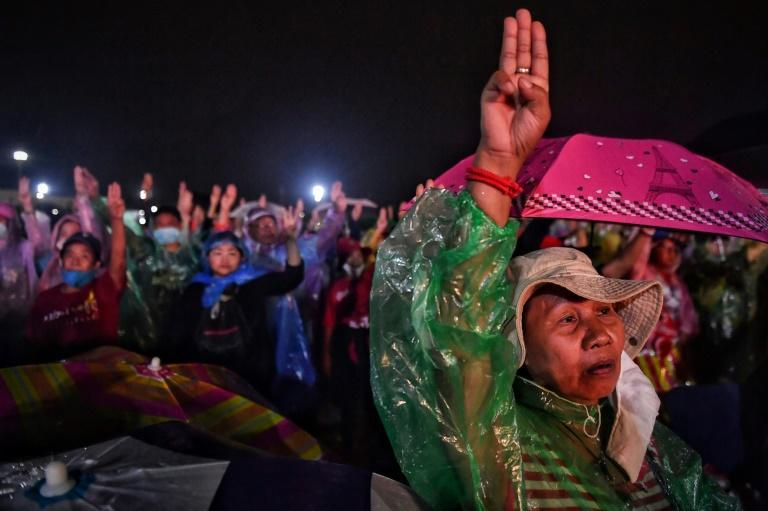 Anti-government protesters make the three-fingered Hunger Games salute as they gather at a pro-democracy rally in Bangkok