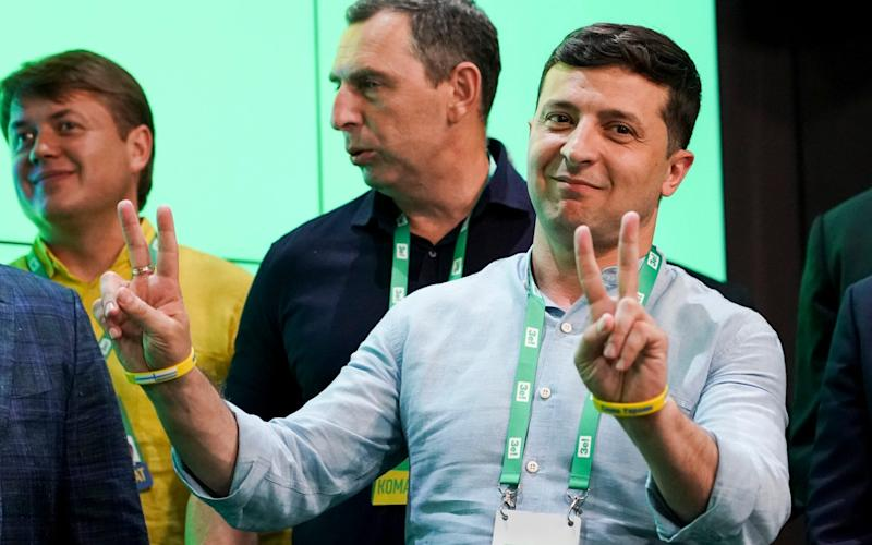 President Volodymyr Zelenskiy speaks at his Servant of the People party's headquarters after the vote Sunday - AP
