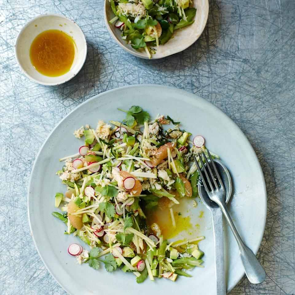 """Pink grapefruit, radishes, and apples liven up this crab salad and add delightful texture. Avocado adds creaminess that pairs wonderfully with crab, and matchsticks of ginger add spice. <a href=""""https://www.epicurious.com/recipes/food/views/crunchy-crab-salad-56389510?mbid=synd_yahoo_rss"""" rel=""""nofollow noopener"""" target=""""_blank"""" data-ylk=""""slk:See recipe."""" class=""""link rapid-noclick-resp"""">See recipe.</a>"""