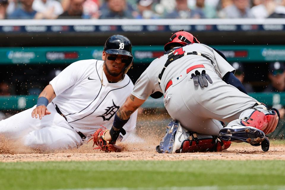 Detroit Tigers shortstop Isaac Paredes (19) is tagged out at home by St. Louis Cardinals catcher Yadier Molina (4) in the sixth inning at Comerica Park, June 23, 2021.