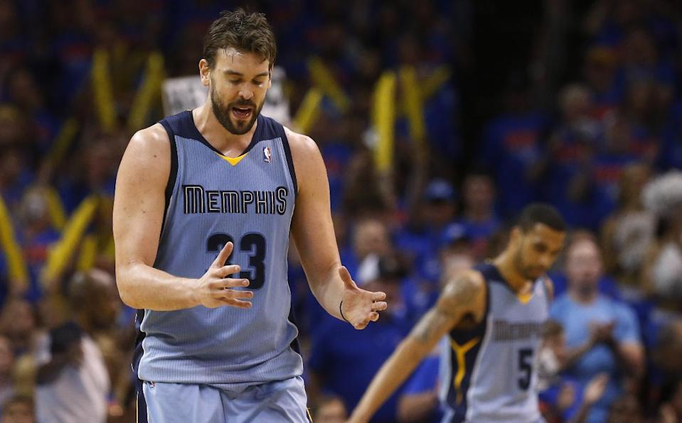 Memphis Grizzlies center Marc Gasol (33) gestures during the fourth quarter of Game 7 of an opening-round NBA basketball playoff series against the Oklahoma City Thunder in Oklahoma City, Saturday, May 3, 2014. Oklahoma City won 120-109. Gasol led Memphis with 24 points. (AP Photo/Sue Ogrocki)