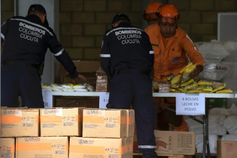Firefighters and civil defense officers arrange US humanitarian aid goods in Cucuta, Colombia, on the border with Tachira, Venezuela, on February 8, 2019 (AFP Photo/Raul ARBOLEDA)