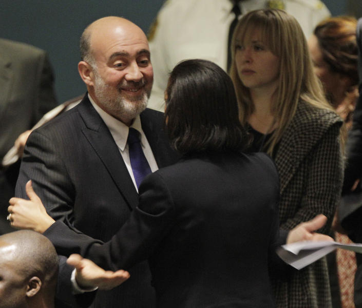 Israel's Foreign Minister Avigdor Lieberman gestures as he embraces the United States Ambassador Susan Rice after speaking during a meeting of the United Nations General Assembly prior to a vote on a resolution on the issue of upgrading the Palestinian Authority's status to non-member observer state in the United Nations headquarters, Thursday, Nov. 29, 2012. (AP Photo/Kathy Willens)