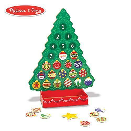 """<p><strong>Melissa & Doug</strong></p><p>amazon.com</p><p><strong>$16.99</strong></p><p><a href=""""https://www.amazon.com/dp/B00EXYG7FG?tag=syn-yahoo-20&ascsubtag=%5Bartid%7C10055.g.4911%5Bsrc%7Cyahoo-us"""" rel=""""nofollow noopener"""" target=""""_blank"""" data-ylk=""""slk:Shop Now"""" class=""""link rapid-noclick-resp"""">Shop Now</a></p><p>This advent calendar is a best-seller for a reason: Once you unveil all 24 magnetic ornaments, the classic wooden tree becomes a mantel-worthy decoration. </p>"""