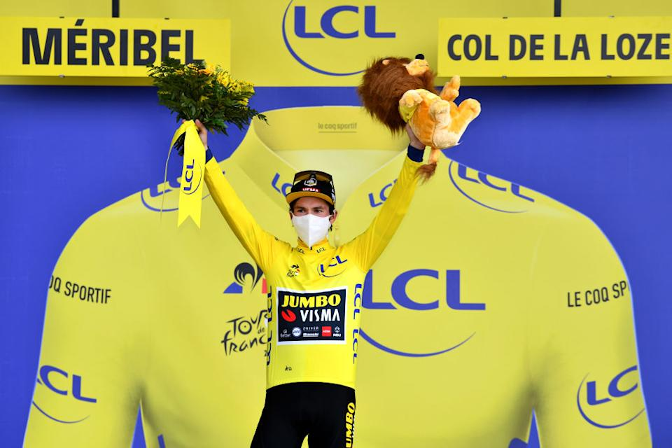 MERIBEL FRANCE  SEPTEMBER 16 Podium  Primoz Roglic of Slovenia and Team Jumbo  Visma Yellow Leader Jersey  Mascot  Flowers  Mask  Covid safety measures  during the 107th Tour de France 2020 Stage 17 a 170km stage from Grenoble to Mribel  Col de la Loze 2304m  TDF2020  LeTour  on September 16 2020 in Mribel France Photo by Stuart FranklinGetty Images