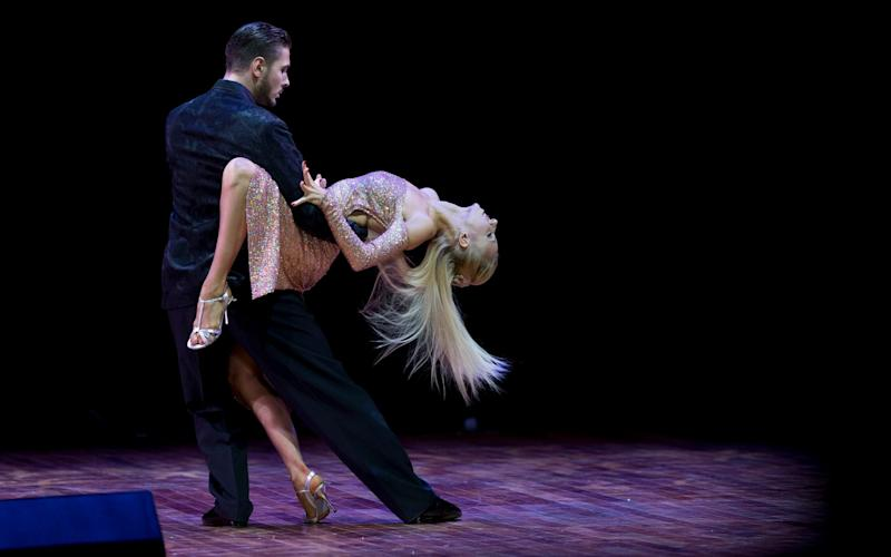 Kirill Parshakov, who was disqualified, competes with his partner Anna Gudyno at the 2015 world tango championship final in Buenos Aires - AP