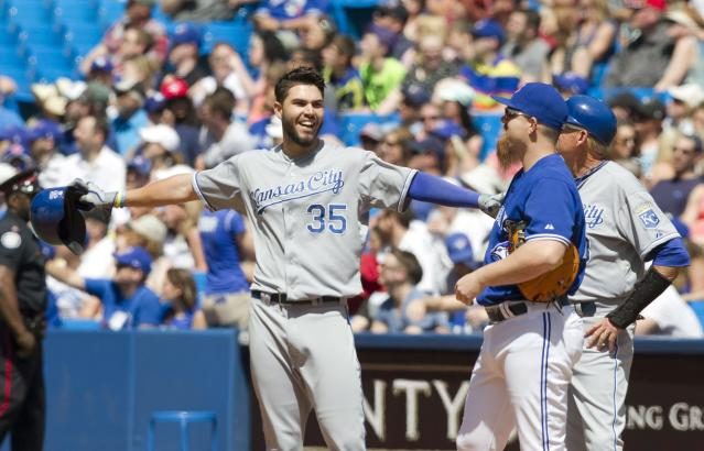 Kansas City Royals Eric Hosmer reacts to review results on play at first base with Toronto Blue Jays first baseman Adam Lind and Royals first base coach Rusty Krtatz during the sixth inning of a baseball game game in Toronto May 31, 2014. Hosmer was called safe and the play was challenged and reviewed but was not overturned. (AP Photo/The Canadian Press, Fred Thornhill)