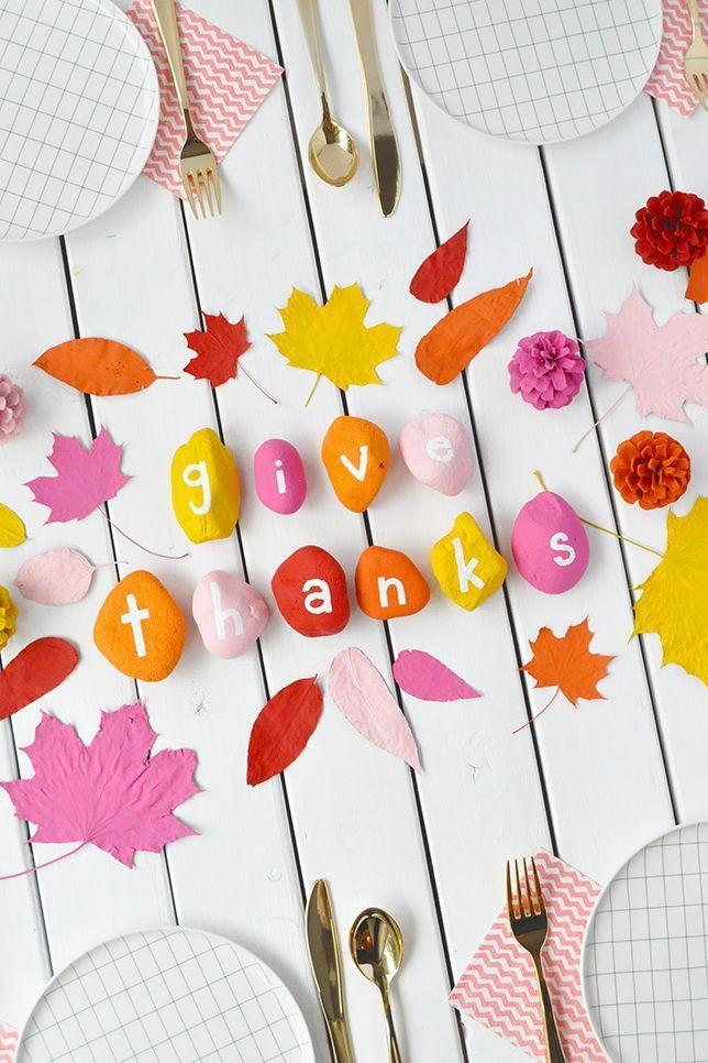 """<p>Convince your kids to pitch in with party prep by painting a bunch of rocks in colorful shades. Then spell out a holiday-appropriate phrase — """"give thanks"""" or """"so grateful"""" — with white paint.</p><p><em><a href=""""https://www.handmadecharlotte.com/painted-rocks-leaves-thanksgiving-table/"""" rel=""""nofollow noopener"""" target=""""_blank"""" data-ylk=""""slk:Get the tutorial at Handmade Charlotte »"""" class=""""link rapid-noclick-resp"""">Get the tutorial at Handmade Charlotte »</a></em></p>"""