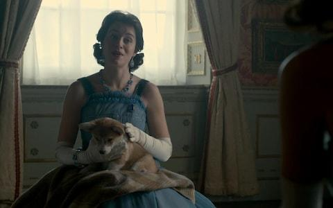 A scene from Season 2 of The Crown showed the Queen in evening dress surrounded by Corgis