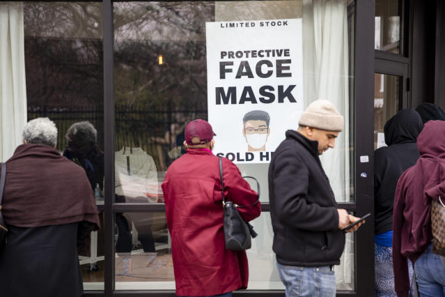 Customers line up outside of a coronavirus pop-up store in Washington, D.C. (Samuel Corum/Getty Images)