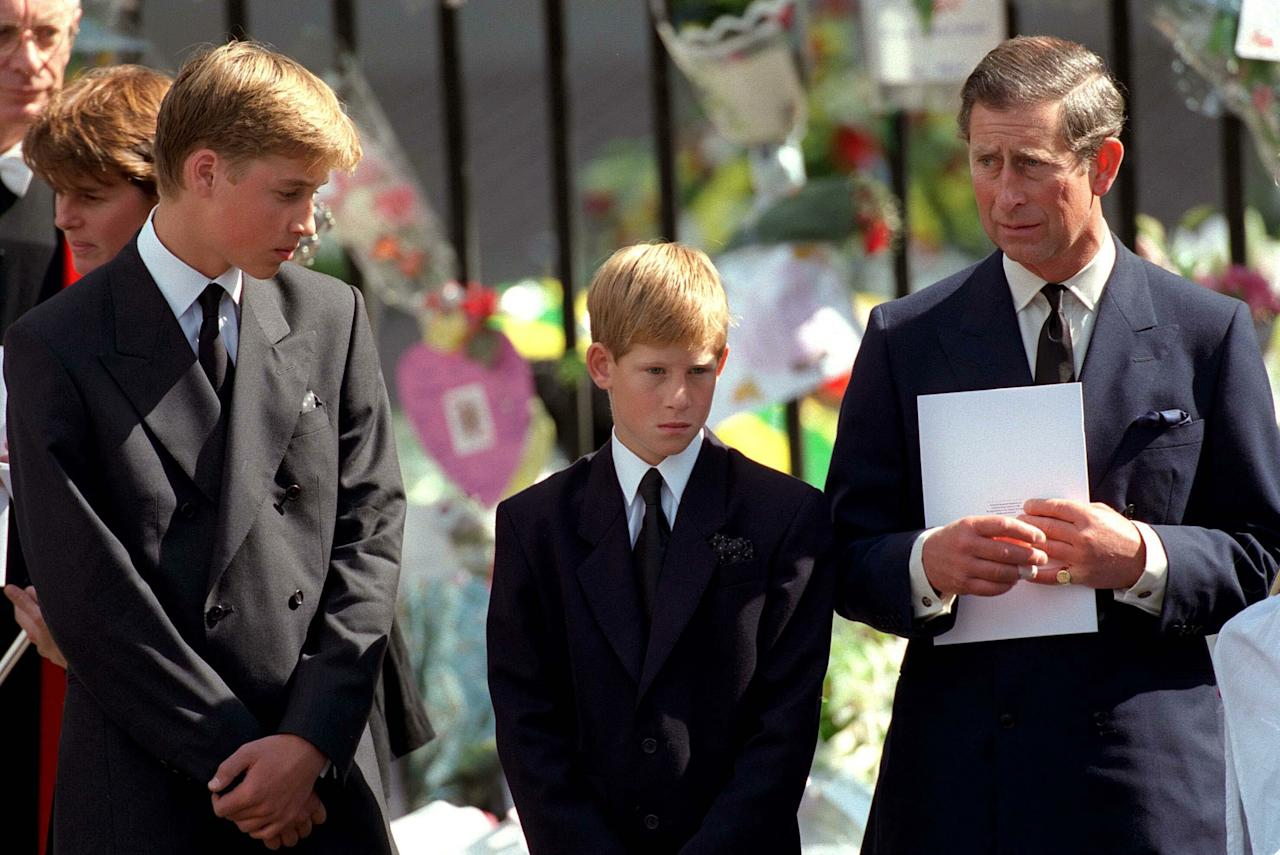 LONDON- SEPTEMBER 6: (FILE PHOTO) Charles, Prince of Wales,  Prince William and Prince Harry stand outside Westminster Abbey at the funeral of Diana, Princess of Wales on September 6, 1997 in London, England.   (Photo by Anwar Hussein/Getty Images)