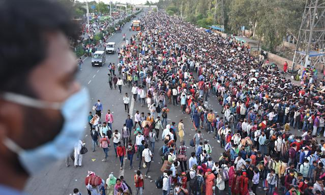 NEW DELHI, INDIA - MARCH 28: A wave of migrant workers seen at Anand Vihar Bus Terminus near the Delhi - UP border following Uttar Pradesh governments call to arrange buses for the workers returning to their native state, on Day 4 of the 21 day nationwide lockdown -- to check the spread of coronavirus, on March 28, 2020 in New Delhi, India. (Photo by Raj K Raj/Hindustan Times via Getty Images)