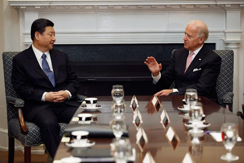 WASHINGTON, DC - FEBRUARY 14: (AFP OUT) U.S. Vice President Joe Biden (R) and Chinese Vice President Xi Jinping talk during an expanded bilateral meeting with other U.S. and Chinese officials in the Roosevelt Room at the White House February 14, 2012 in Washington, DC. While in Washington, Vice President Xi will meet with Biden, President Barack Obama and other senior Administration officials to discuss a broad range of bilateral, regional, and global issues. (Photo by Chip Somodevilla/Getty Images)