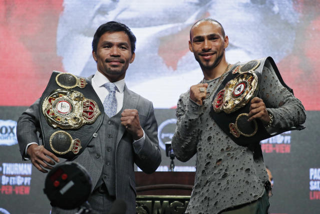 Manny Pacquiao (L) and Keith Thurman pose during a news conference Wednesday, July 17, 2019, in Las Vegas ahead of their welterweight title match on Saturday in Las Vegas. (AP Photo/John Locher)