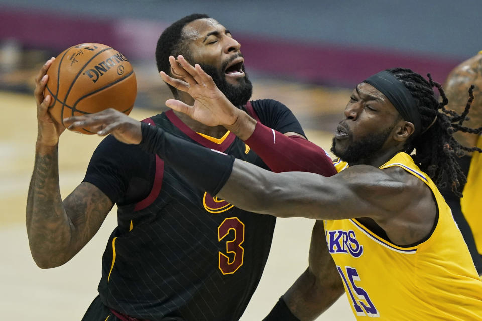 Cleveland Cavaliers' Andre Drummond (3) drives past Los Angeles Lakers' Montrezl Harrell (15) in the first half of an NBA basketball game, Monday, Jan. 25, 2021, in Cleveland. (AP Photo/Tony Dejak)