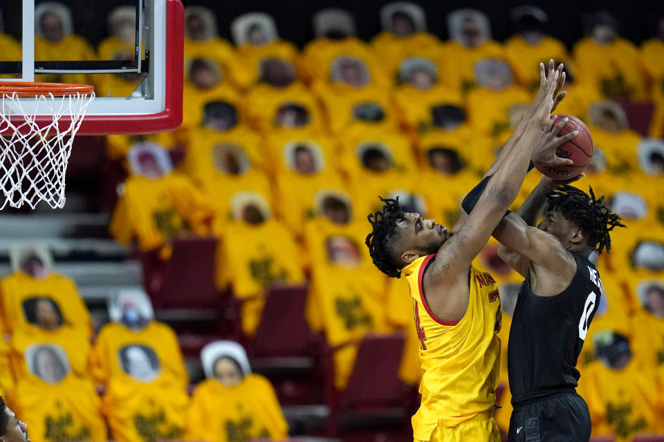Michigan State forward Aaron Henry, right, goes up for a shot against Maryland forward Donta Scott during the second half of an NCAA college basketball game, Sunday, Feb. 28, 2021, in College Park, Md. Maryland won 73-55. (AP Photo/Julio Cortez)