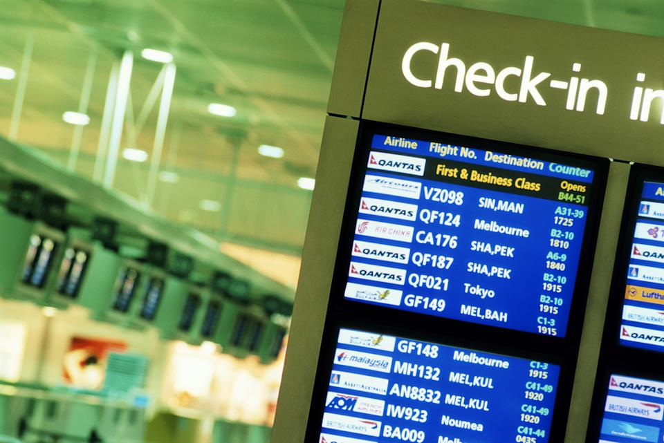 Pictured is a check-in board at the international airport.