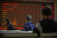 Chinese investors monitor stock prices at a brokerage house in Beijing, Tuesday, Nov. 19, 2019. Asian shares were mixed Tuesday as investor sentiment remained cautious amid worries about the next development in trade talks between the United States and China. (AP Photo/Mark Schiefelbein)