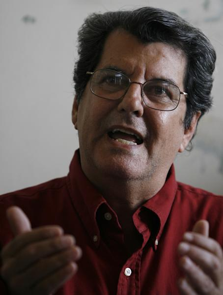 FILE - In this Nov. 22, 2007, file photo, Cuban dissident Oswaldo Paya speaks during a news conference in Havana. Paya died in a car crash. He was 60 years old. Dissident Elizardo Sanchez says he confirmed Paya's death on Sunday, July 22, 2012, with associates in the city of Bayamo, 500 miles (800 kilometers) east of the capital. (AP Photo/Javier Galeano, file)