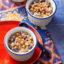 """<p>Farro is often served as a side dish but it's a great choice for breakfast, too. In this overnight cereal recipe, nutty whole-grain farro is joined by fresh, sweet blueberries and maple syrup. Unsalted, toasted almonds add a welcome crunch! <a href=""""http://www.eatingwell.com/recipe/268380/farro-almond-blueberry-breakfast-cereal/"""" rel=""""nofollow noopener"""" target=""""_blank"""" data-ylk=""""slk:View recipe"""" class=""""link rapid-noclick-resp""""> View recipe </a></p>"""