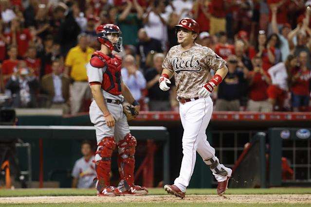 Not known for his power, Cincinnati's Scooter Gennett hit four home runs on Tuesday. (AP Images)