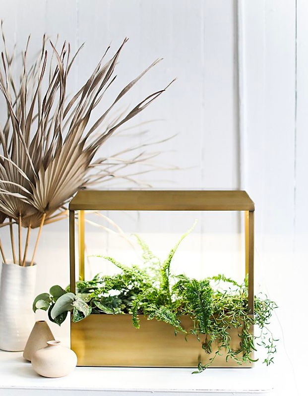 "This plant house is great for dorms because it's stylish, compact, and will sustain a year-round garden inside small spaces. From basil and rosemary to cacti and succulents, it's a suitable home for so many <a href=""https://www.glamour.com/gallery/houseplants-for-beginners?mbid=synd_yahoo_rss"" rel=""nofollow noopener"" target=""_blank"" data-ylk=""slk:green friends"" class=""link rapid-noclick-resp"">green friends</a>. $189, Free People. <a href=""https://www.freepeople.com/shop/grow-house/"" rel=""nofollow noopener"" target=""_blank"" data-ylk=""slk:Get it now!"" class=""link rapid-noclick-resp"">Get it now!</a>"