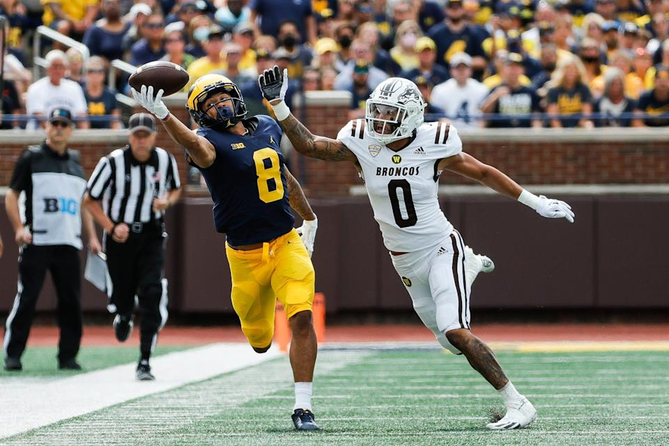 Michigan wide receiver Ronnie Bell reaches for a catch against Western Michigan cornerback DaShon Bussell during the first half in Ann Arbor on Saturday, Sept. 4, 2021. The play was ruled as offense pass interference.