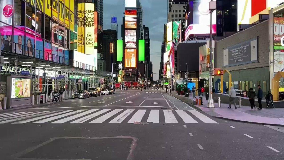 New York's Times Square Near-Deserted as City Goes Into ...