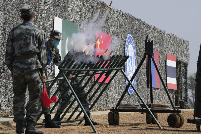Chinese soldiers let off signal flares during the Shared Destiny 2021 drill at the Queshan Peacekeeping Operation training base in Queshan County in central China's Henan province Wednesday, Sept. 15, 2021. Peacekeeping troops from China, Thailand, Mongolia and Pakistan took part in the 10 days long exercise that field reconnaissance, armed escort, response to terrorist attacks, medical evacuation and epidemic control. (AP Photo/Ng Han Guan)
