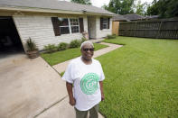 Doris Brown poses outside her home Friday, July 31, 2020, in Houston. Brown's home flooded during Harvey and she's part of a group called the Harvey Forgotten Survivors Caucus. (AP Photo/David J. Phillip)