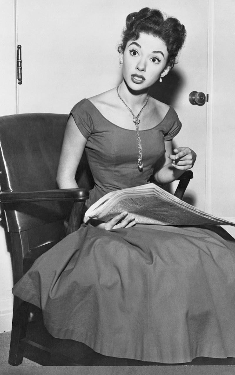 The actress wears a wide-neck dress in this undated photo.