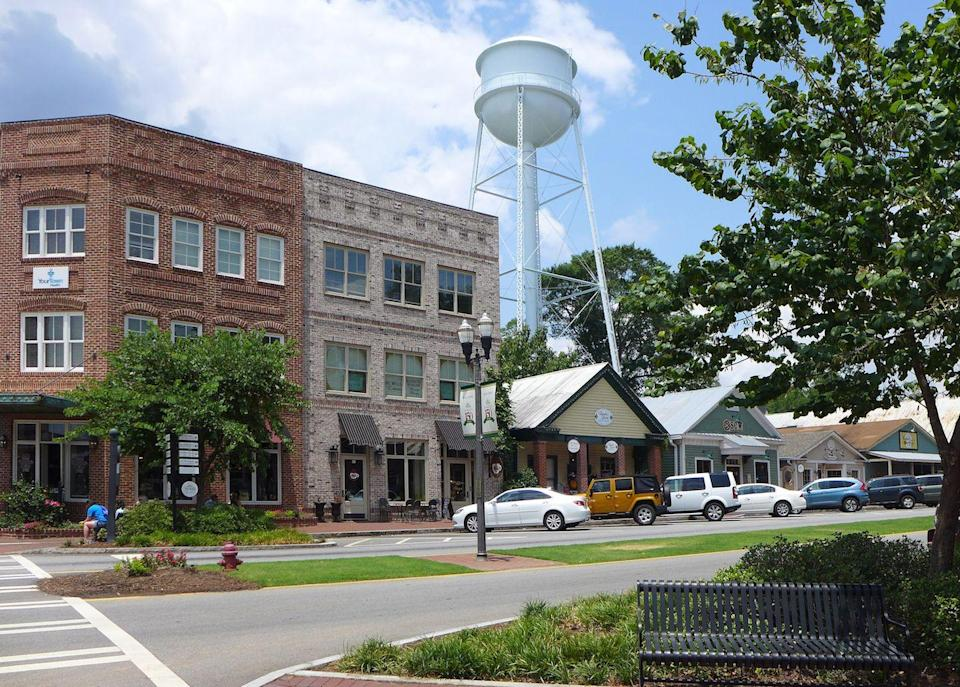 """<p>Senoia is famous for being a filming location for <em>The Walking Dead</em>, with plenty of tours catering to fans. (There's also <a href=""""http://nicandnormans.com/"""" rel=""""nofollow noopener"""" target=""""_blank"""" data-ylk=""""slk:Nic & Norman's"""" class=""""link rapid-noclick-resp"""">Nic & Norman's</a>, a restaurant owned by <em>The Walking Dead</em> star Norman Reedus and director/producer Greg Nicotero.) But before that huge hit, residents have been attracted to this adorable town for its historic architecture and quaint shops. The town planned for """"smart growth"""" without sacrificing character with the help of <a href=""""http://www.historicalconcepts.com/communities/towns-villages-hamlets/senoia-historic-district"""" rel=""""nofollow noopener"""" target=""""_blank"""" data-ylk=""""slk:Historical Concepts"""" class=""""link rapid-noclick-resp"""">Historical Concepts</a>.</p><p><a href=""""https://www.housebeautiful.com/lifestyle/g3345/historic-homes/"""" rel=""""nofollow noopener"""" target=""""_blank"""" data-ylk=""""slk:Peek inside 50 famous historic homes »"""" class=""""link rapid-noclick-resp""""><em>Peek inside 50 famous historic homes »</em></a></p>"""