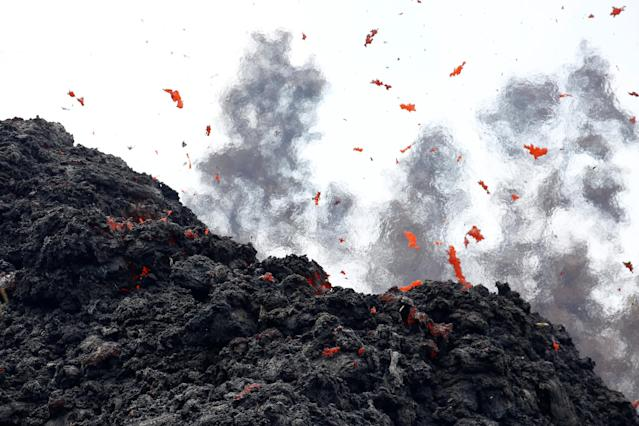 <p>Lava erupts from a fissure east of the Leilani Estates subdivision during ongoing eruptions of the Kilauea Volcano in Hawaii, on May 12, 2018. (Photo: Terray Sylvester/Reuters) </p>