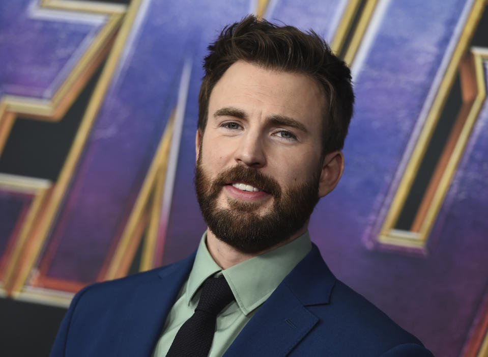 """FILE - In this April 22, 2019 file photo, Chris Evans arrives at the premiere of """"Avengers: Endgame"""" at the Los Angeles Convention Center. The """"Captain America"""" actor returned to his native Massachusetts to help dedicate the new home of a youth theater company where as a youngster he honed his acting skills. Evans helped cut the ribbon Saturday, Oct. 19 at the Concord Youth Theatre's permanent home. Evans, who grew up in nearby Sudbury, acted in Concord Youth Theatre productions starting when he was 9 years old. His mother, Lisa Evans, is the theater's director.  (Photo by Jordan Strauss/Invision/AP, File)"""