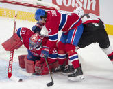 Montreal Canadiens goaltender Carey Price (31) grabs the puck as defenseman Ben Chiarot (8) and Ottawa Senators left wing Brady Tkachuk (7) look for the rebound during the first period of an NHL hockey game Tuesday, March 2, 2021, in Montreal. (Ryan Remiorz/The Canadian Press via AP)