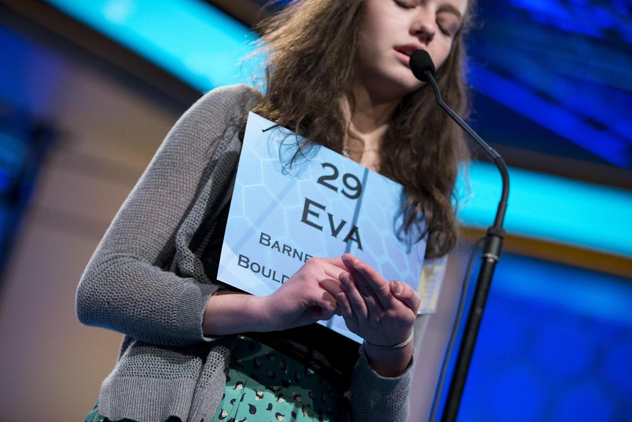 "Eva Kitlen, 14, of Niwot, Colo., writes out the word ""kleptocrat"" in her hand before spelling it correctly during the semifinal round of the National Spelling Bee, Thursday, May 30, 2013, in Oxon Hill, Md. (AP Photo/Evan Vucci)"
