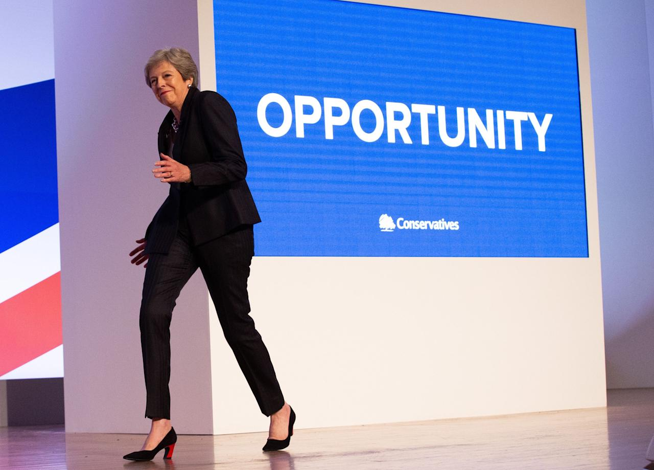 <p>Theresa May dancing onto the stage to the tune of 'Dancing Queen' by Abba, before she delivers her Leaders' speech to the Conservative Party Conference in Birmingham. (Rex) </p>
