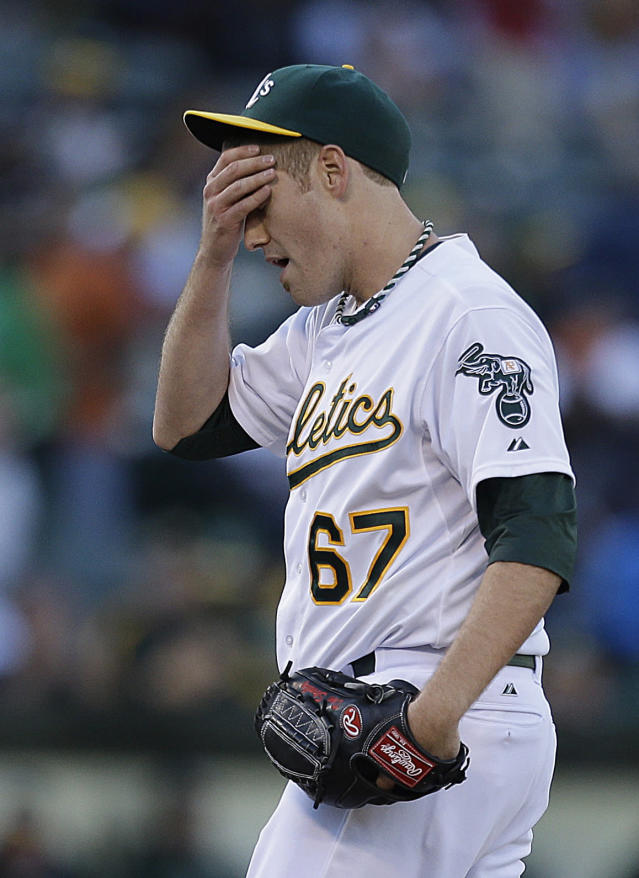 Oakland Athletics' Dan Straily wipes his face in the first inning of a baseball game against the Los Angeles Angels, Thursday, July 25, 2013, in Oakland, Calif. (AP Photo/Ben Margot)
