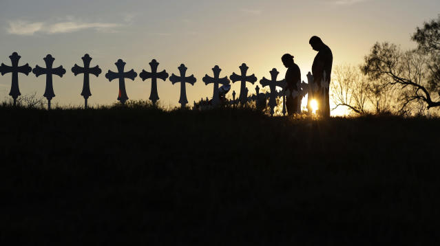 <p>Kenneth and Irene Hernandez pay their respects as they visit a makeshift memorial with crosses placed near the scene of a shooting at the First Baptist Church of Sutherland Springs, Monday, Nov. 6, 2017, in Sutherland Springs, Texas. (Photo: Eric Gay/AP) </p>