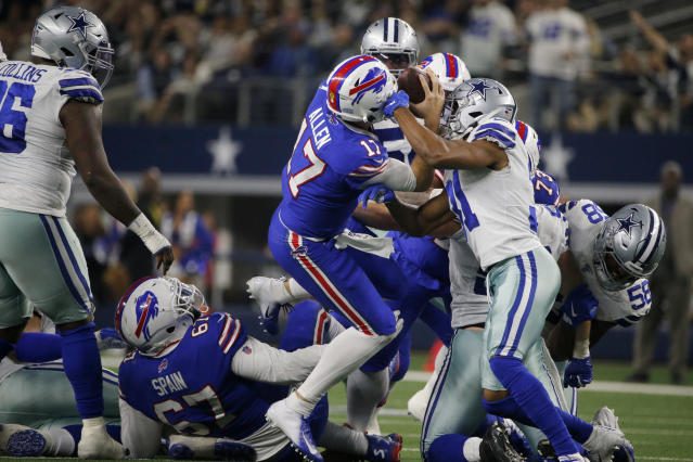 Buffalo Bills quarterback Josh Allen (17) fights for a first down after recovering a fumbled snap as Dallas Cowboys cornerback Byron Jones (31) defends in the first half of an NFL football game in Arlington, Texas, Thursday, Nov. 28, 2019. (AP Photo/Michael Ainsworth)