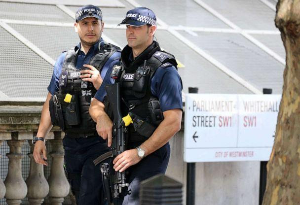 PHOTO: Armed British Metropolitan Police officers carry their guns as they patrol on Whitehall in central London on May 23, 2019. (Isabel Infantes/AFP/Getty Images, FILE)