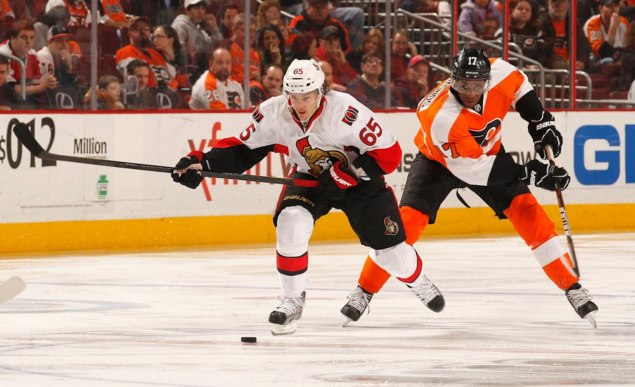 PHILADELPHIA, PA - MARCH 31: Erik Karlsson #65 of the Ottawa Senators and Wayne Simmonds #17 of the Philadelphia Flyers go after the puck during the second period at Wells Fargo Center on March 31, 2012 in Philadelphia, Pennsylvania.  (Photo by Rob Carr/Getty Images)