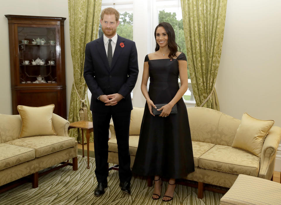 Prince Harry and Meghan Markle, who wore a custom Gabriela Hearst dress, at a reception on their first night in New Zealand. (Photo: Getty Images)