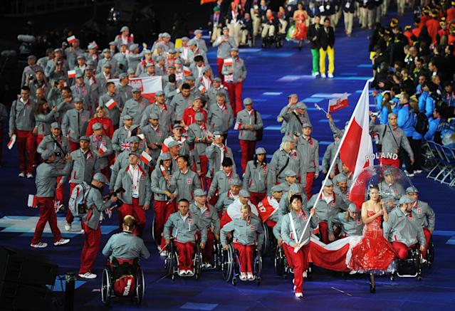 LONDON, ENGLAND - AUGUST 29: Athlete Renata Chilewska of Poland carries the flag during the Opening Ceremony of the London 2012 Paralympics at the Olympic Stadium on August 29, 2012 in London, England. (Photo by Gareth Copley/Getty Images)