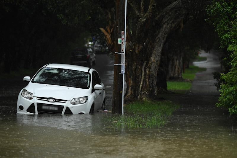 A car seen under floodwater at Marrickville in Sydney, Sunday, February 9, 2020.
